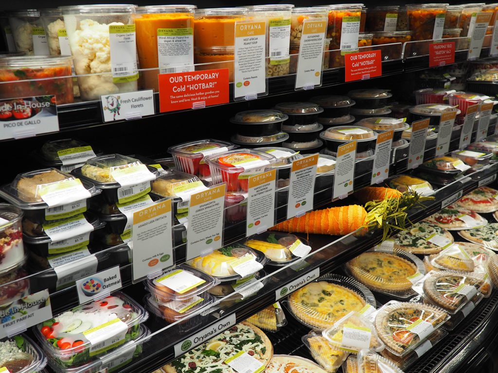 Pre-packaged meals on a refrigerated shelf at Oryana 10th Street